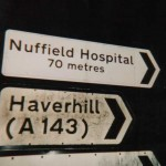 An illegal distance sign to Nuffield Hostpital, in Bury St. Edmunds, Suffolk, amended by ARM.