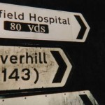 Yet another illegal distance sign to Nuffield Hostpital, in Bury St. Edmunds, Suffolk, amended by ARM.