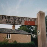 A metric footpath sign at Nazeing, Essex, amended by A.R.M.