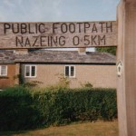 A metric footpath sign at Nazeing, Essex, before.